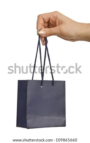 Hand and gift bag on white
