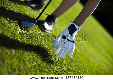 Hand and golf ball