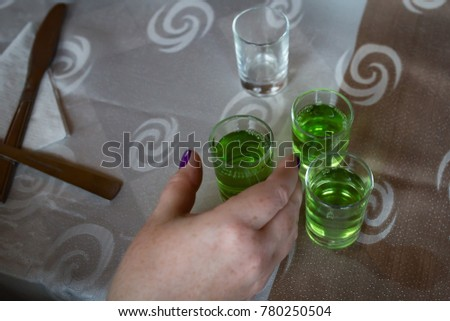 Hand and green chacha shots
