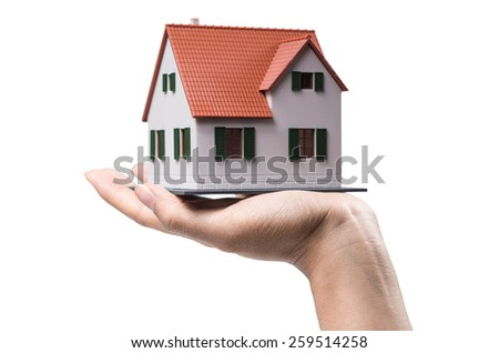 Hand and house(Clipping path included) - stock photo