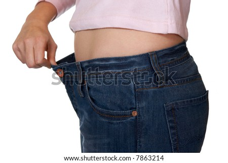 Hand and jeans - weight loss, isolated on white background