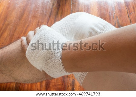 Hand and knee injury with a bandage