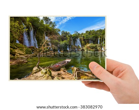 Hand and Kravice waterfall in Bosnia and Herzegovina (my photo) isolated on white background