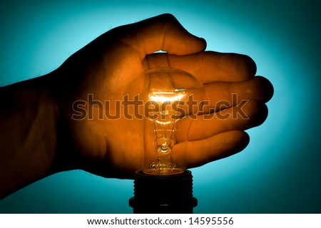 Hand and lamp - stock photo
