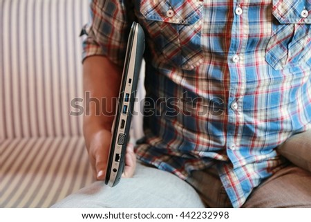 hand and lan network cable with people work on laptop - stock photo