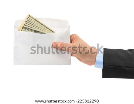 Hand and money in envelope isolated on white background - stock photo
