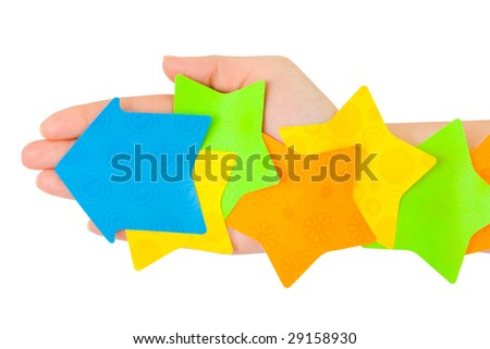 Hand and multicolored note paper isolated on white background