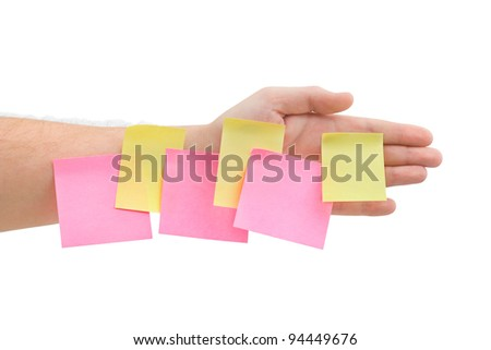 Hand and note paper isolated on white background