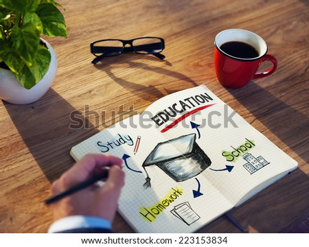 Hand and Notepads with Education Concepts - stock photo