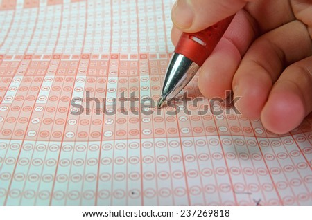 hand and pen playing luck game checking numbers - stock photo