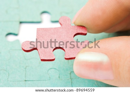 Hand and puzzle - concept background - stock photo