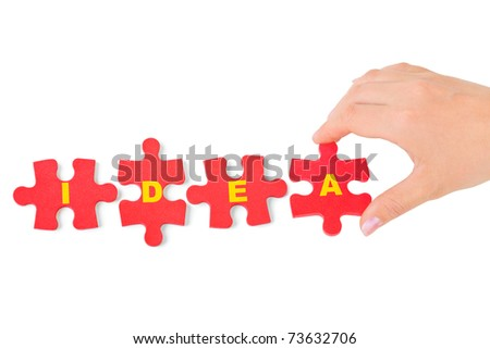 Hand and puzzle Idea isolated on white background - stock photo