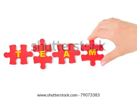 Hand and puzzle Team isolated on white background