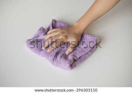 Hand and rag cloth cleaning on white background - stock photo