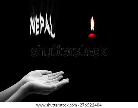 Hand and red candle , Pray for Nepal