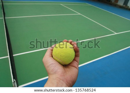 hand and tennis ball - stock photo