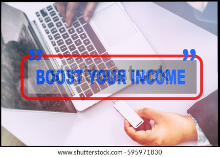 "Hand and text  ""BOOST YOUR INCOME"" with vintage background. Technology concept."