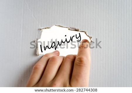 Hand and text on the cardboard background Inquiry - stock photo