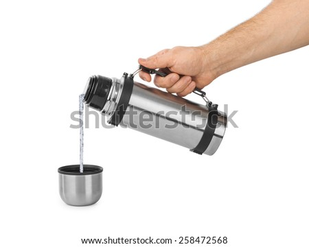 Hand and thermos flask isolated on white background - stock photo