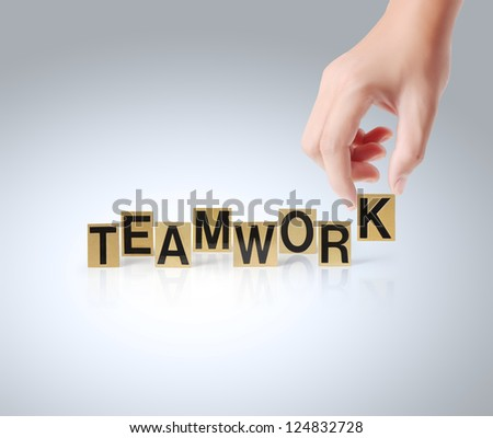 Hand and word Teamwork isolated on a white background - stock photo