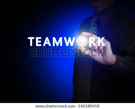 Hand and word Teamwork with gear - stock photo