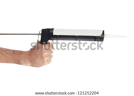 Hand applying silicone with caulking gun isolated on white, clipping path included - stock photo