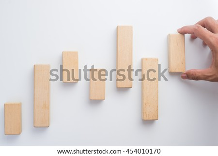 Hand aranging wood block. Business concept for growth success process. - stock photo