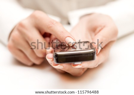 Hand are using smart phone - stock photo