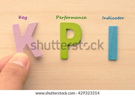 Hand arrange letters as KPI (Key , Performance , Indicator) - stock photo