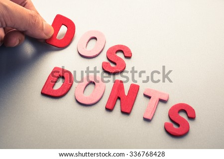 Hand arrange wood letters as Do and Don't instruction concept - stock photo