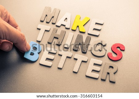 Hand arrange wood letters as Make Things Better phrase for motivation concept - stock photo