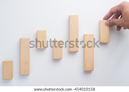 Hand arranging wood block. Business concept for growth success process. - stock photo