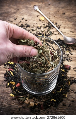 hand asiausa tea brew in transparent jar in country style.Selective focus - stock photo