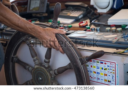 Hand at the wheel