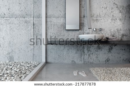 Hand basin in a modern restroom with pebble decor and marble floor and walls with a pair of slip slops - stock photo