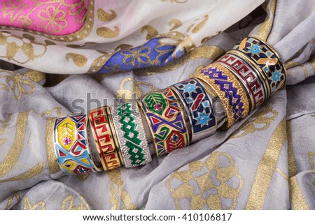 Hand bracelet on a silk background, Handmade Bracelet with Caucasus ornaments