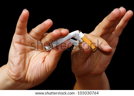 Hand breaking a cigarette. Stop smoking - stock photo