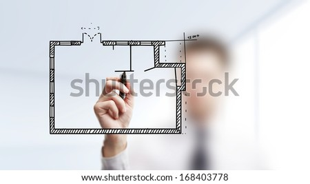 hand businessman drawing plan apartment - stock photo