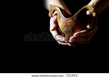 Hand-carved Afghani  shepherds bowl  - can represent art, artists, or supporting the arts. - stock photo