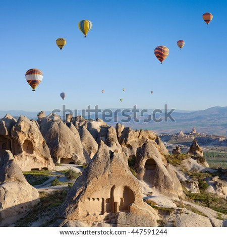 Hand carved rooms in unusual rock formation in Goreme, Cappadocia, Turkey. Hot air ballooning in morning is most amazing attraction in Kapadokya. - stock photo