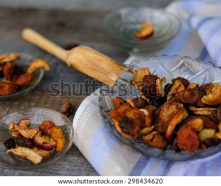 hand carved  wooden scoop and dried fruit on vintage background - stock photo