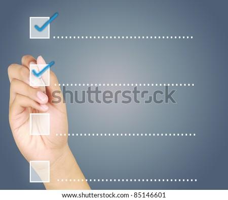 Hand check mark on a touchscreen button - stock photo