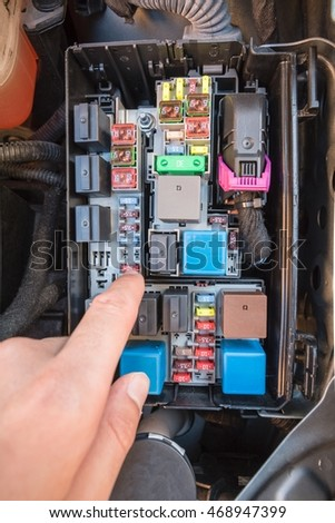 hand checking fuse fuse box modern stock photo royalty free rh shutterstock com modern fuse box explained modern fuse box for classic beetle