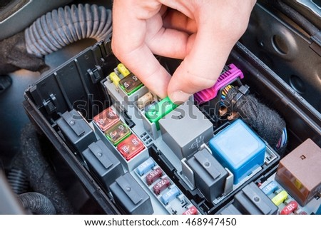 stock photo hand checking a fuse in the fuse box of a modern car engine 468947450 car fuse\