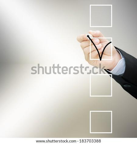 Hand choosing one of three options  - stock photo