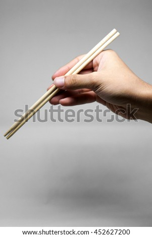 Hand chopstick sticking together
