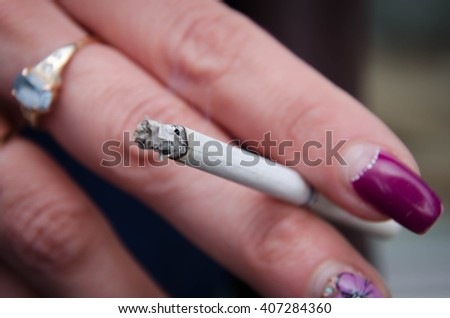 Hand cigarette,smoke - stock photo
