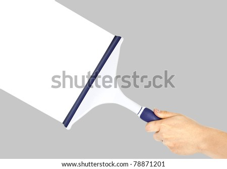 Hand cleaning grey window - stock photo