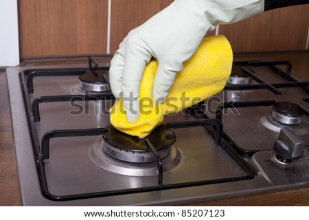 Hand cleaning stove. - stock photo