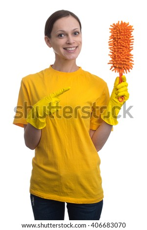 Hand cleaning. Young woman with yellow rubber gloves preparing to clean - stock photo
